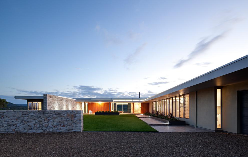 Casas em l 63 projetos com plantas e fotos para se inspirar for Casa moderna l
