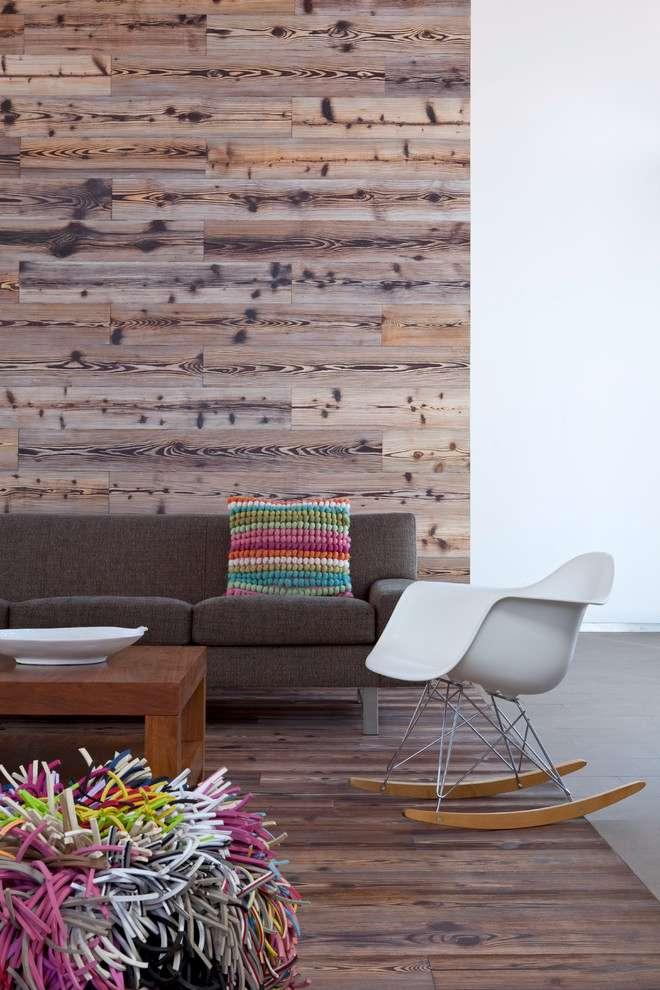A continuidade entre o piso e a parede é uma ótima alternativa para delimitar o espaço da sala, conforme o exemplo abaixo