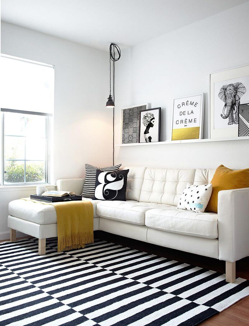 Decoração preto e branca é pratica e fácil para uma sala simples