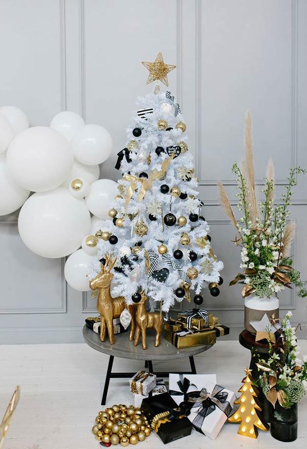 Dourado e preto numa decoração glam