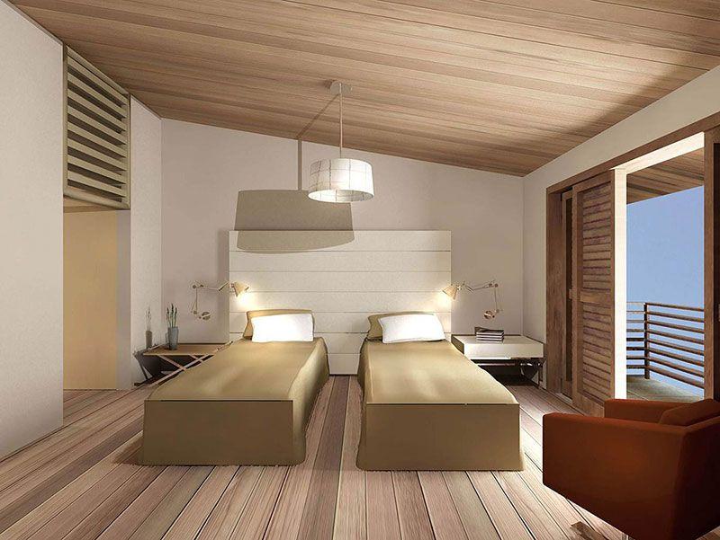 Una duas camas de solteiro para ter uma cama de casal em um quarto de hóspedes