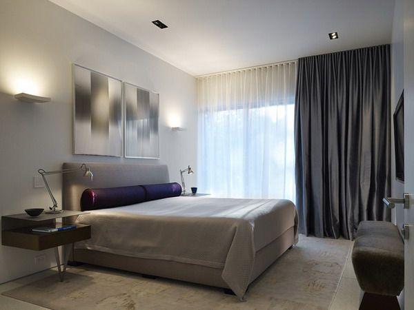 Um toque de delicadeza com o tecido de cetim em um quarto com decoração neutra
