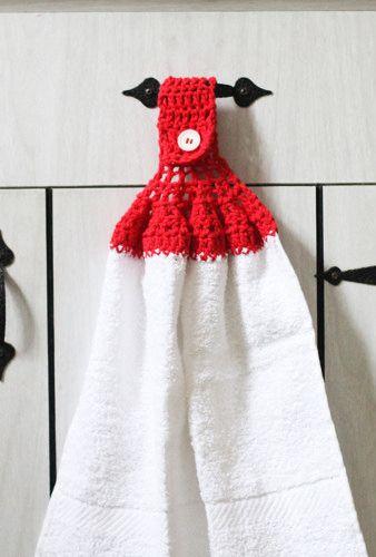 Um detalhe fofo para a toalha de mão no banheiro