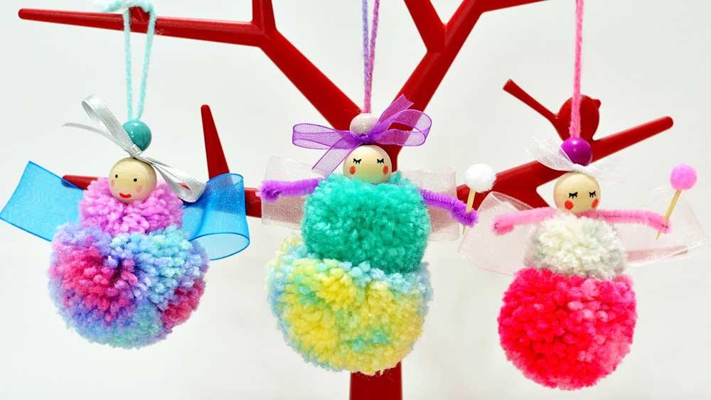 Bonecas com pompom de lã