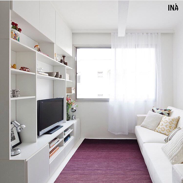 Sala com tapete marcante
