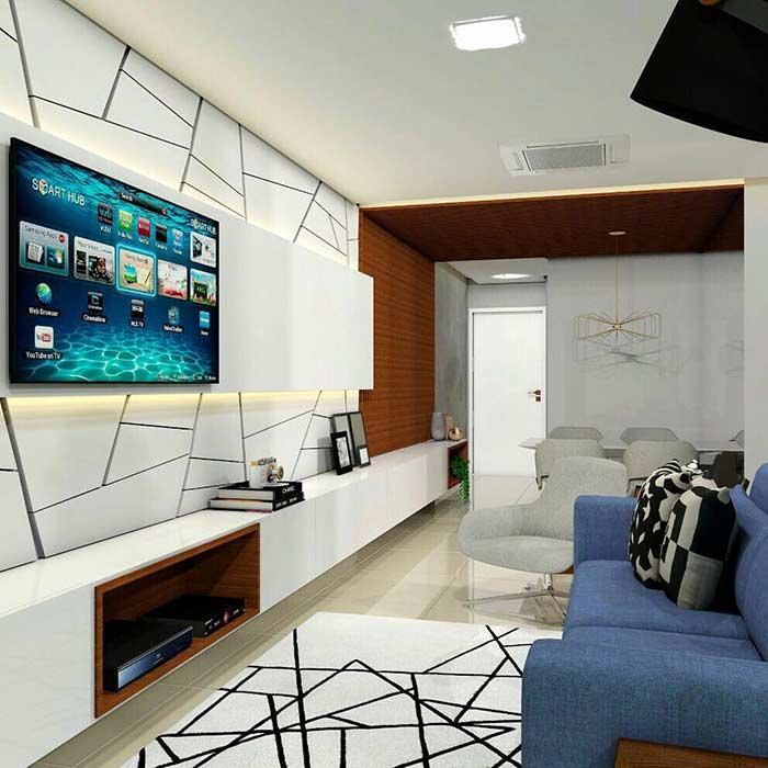 Decoração de sala pequena com painel geométrico e tapete que segue o mesmo estilo