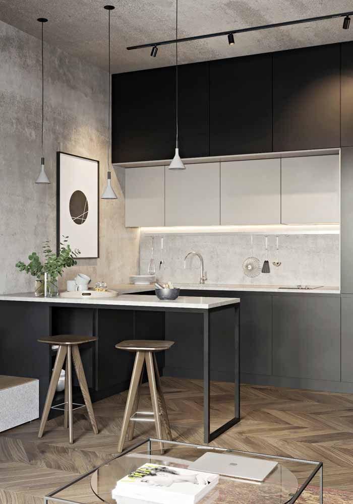 Cozinha moderna com armários pretos