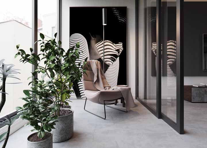 Os vasos de cimento da varanda conversam harmoniosamente com o restante da decoração