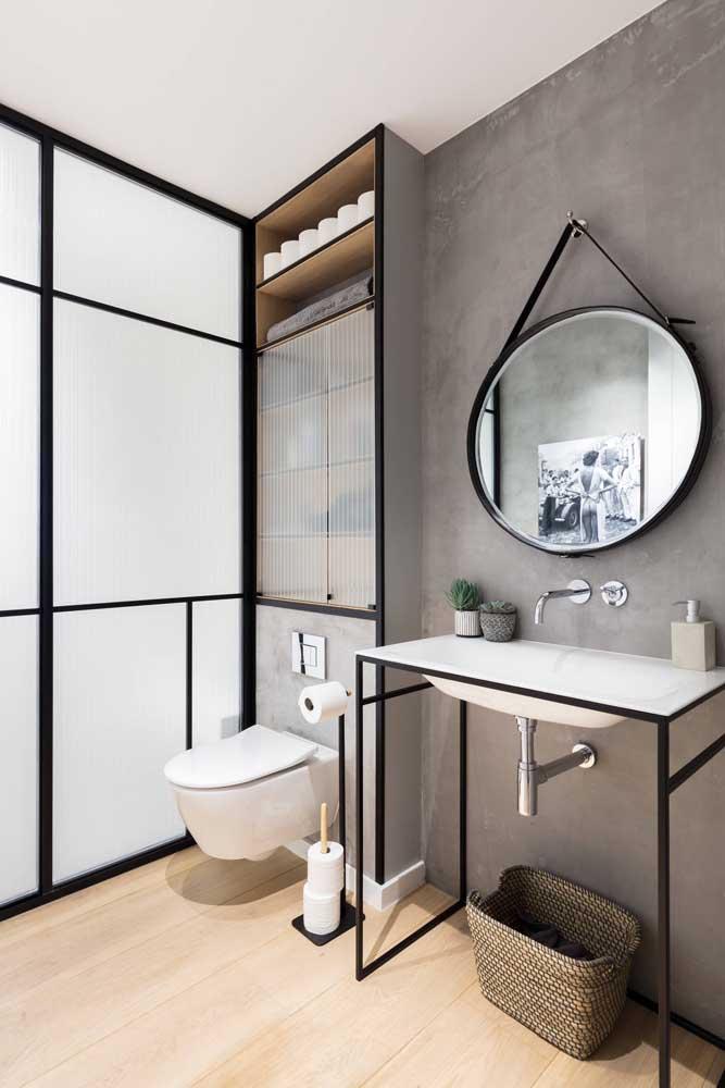 Lavabo decorado em estilo industrial com parede de cimento queimado e detalhes em ferro