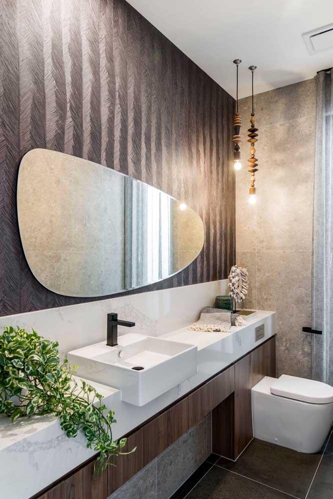 Formatos diferenciados e materiais escolhidos a dedo tornam esse lavabo um modelo para se inspirar