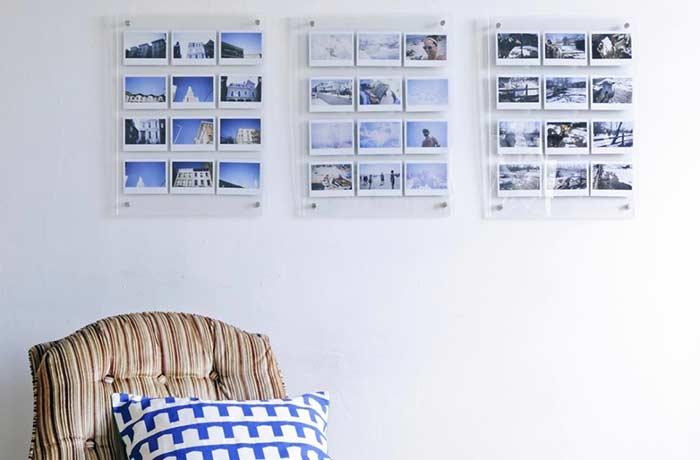 Seleção de fotos num tríptico feito de acrílico