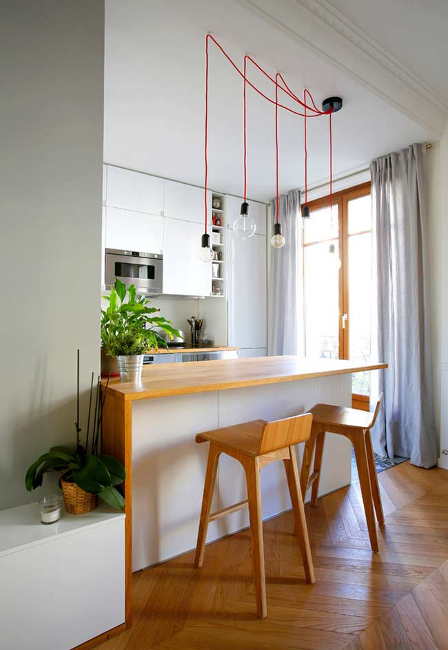 Distribua pontos de luz em uma cozinha americana simples