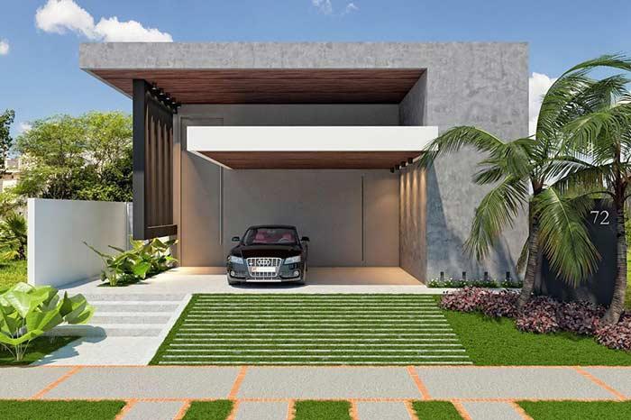 Casa linda com fachada de concreto e cobertura suspensa