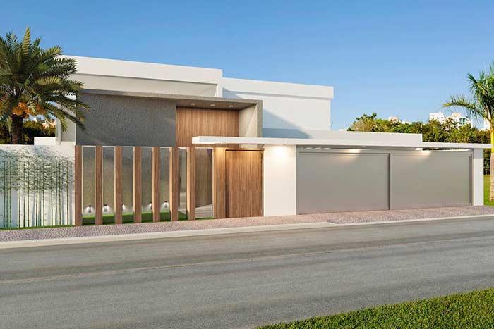 Casa com muro de vidro e madeira