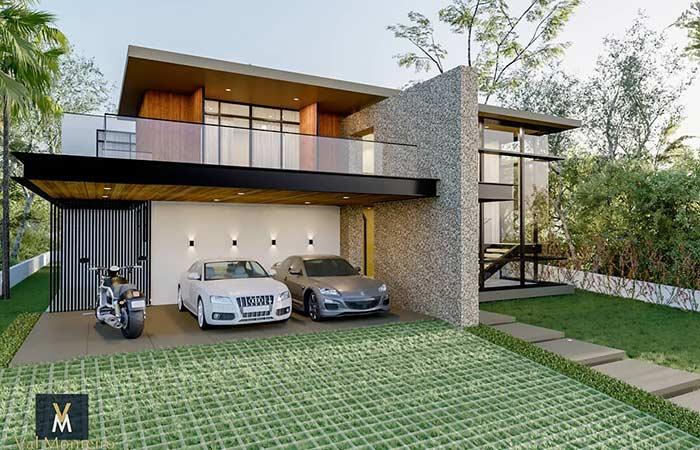 com garagem aberta, varanda e concregrama