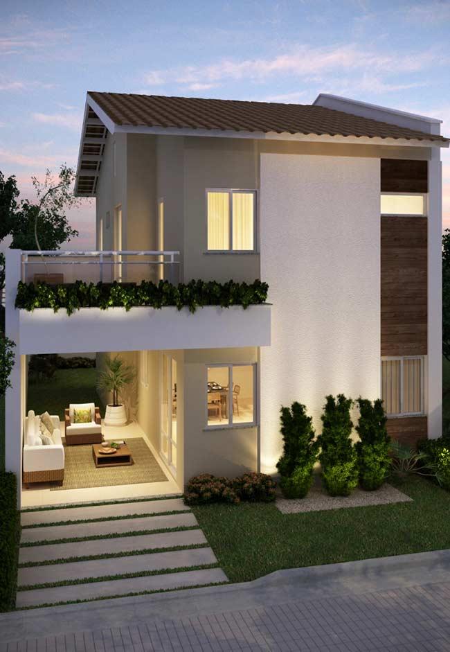 Casa com telhado colonial duas águas