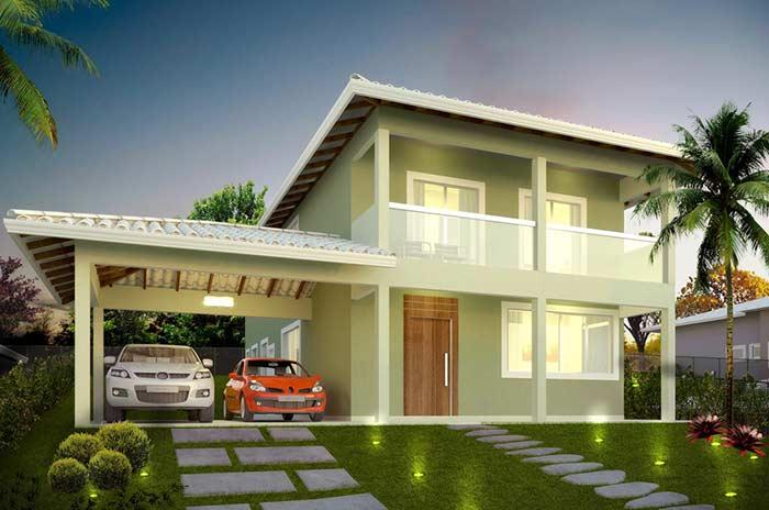 Cores suaves na fachada de residência com telhado colonial