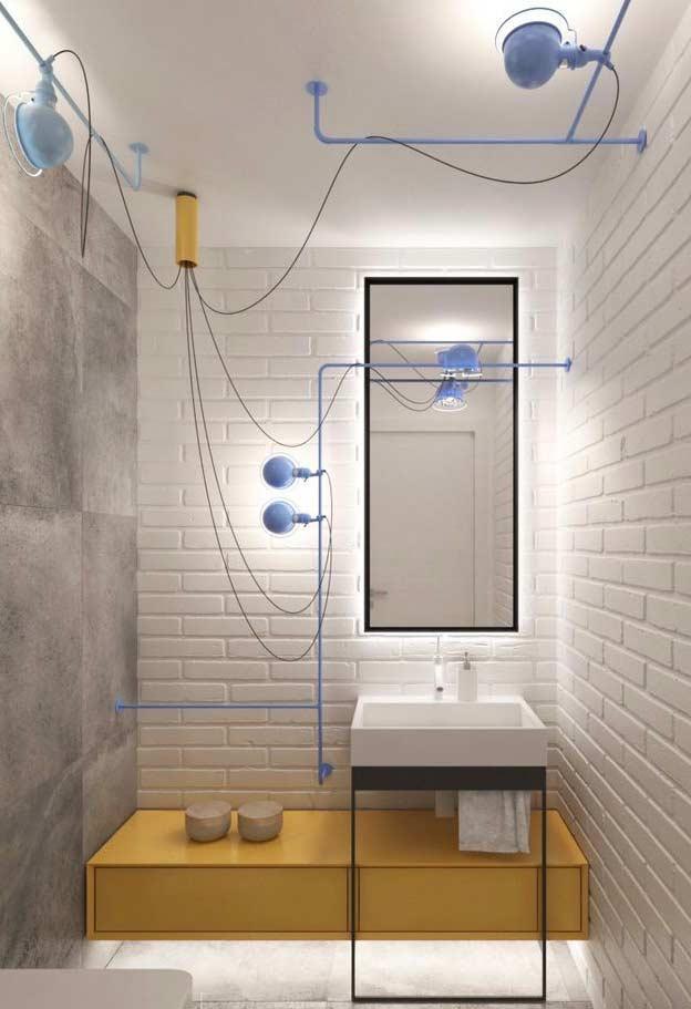 Divida os pontos de luz numa decoração mais industrial