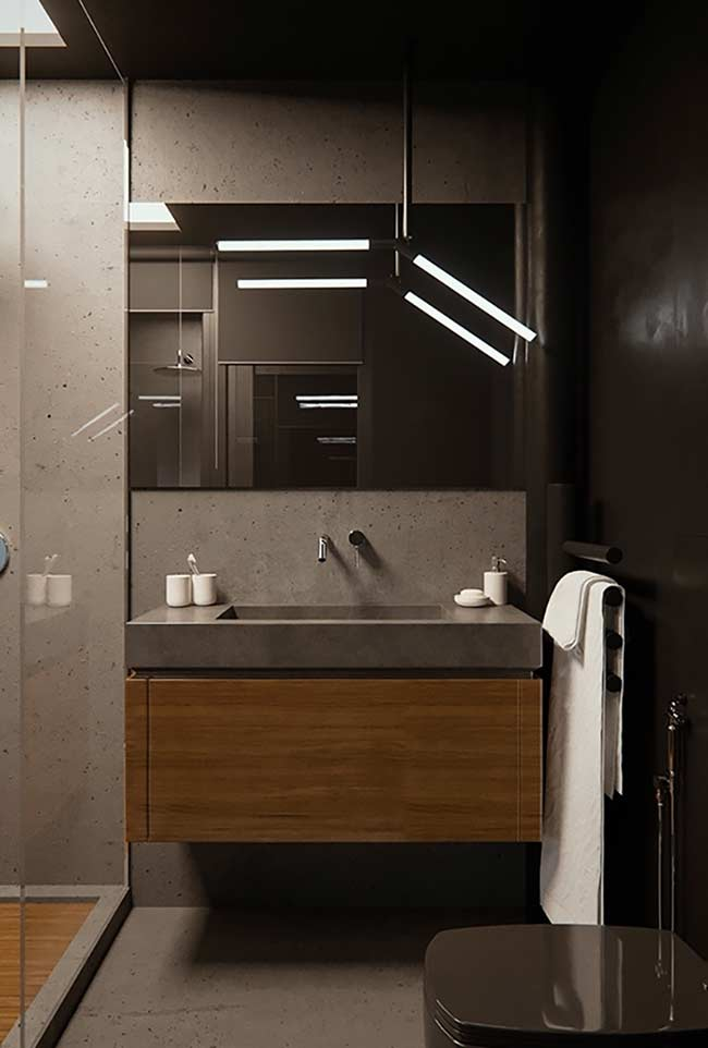 Cinza e marrom para um banheiro mais sério e sóbrio