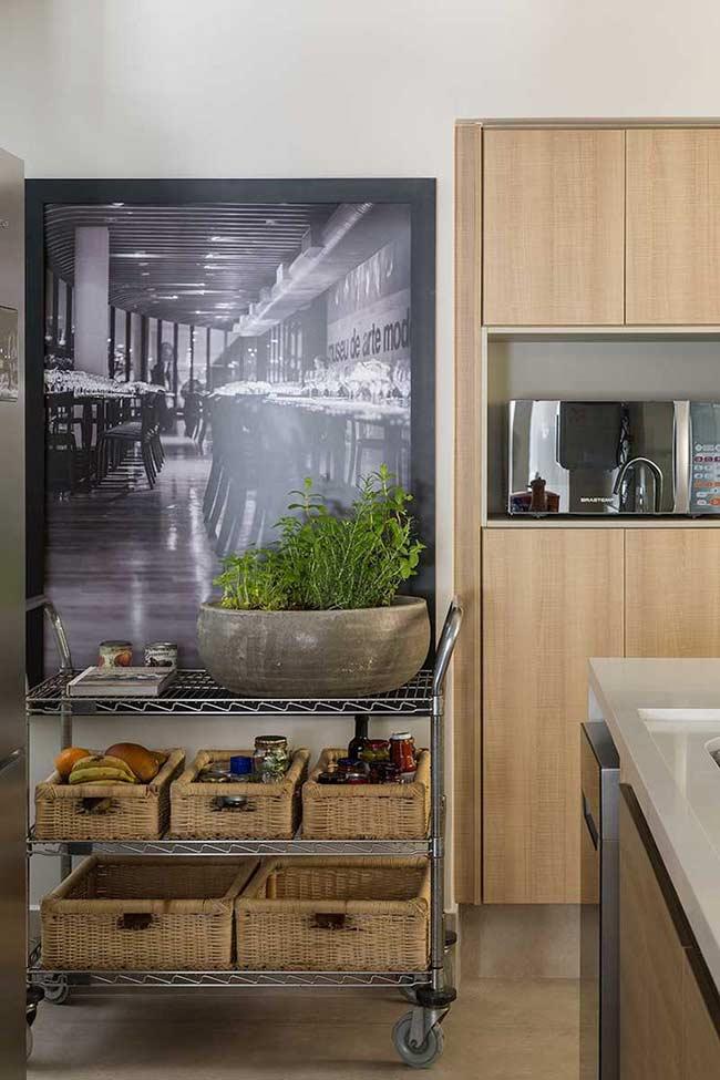 Destaque o ambiente com um quadro para cozinha