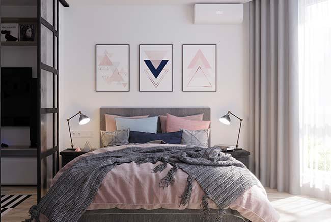 Quadros de formas geométricas combinando com as cores da cama