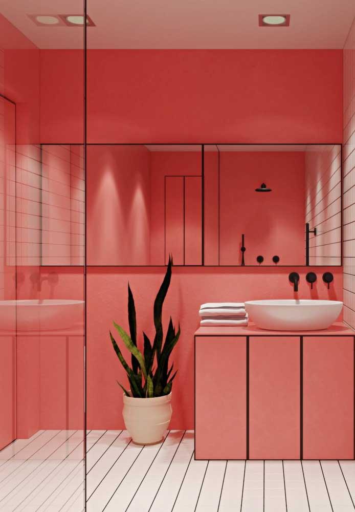 Você pode usar o tom de rosa mais claro para fazer a decoração do banheiro combinando com os detalhes na cor preta.