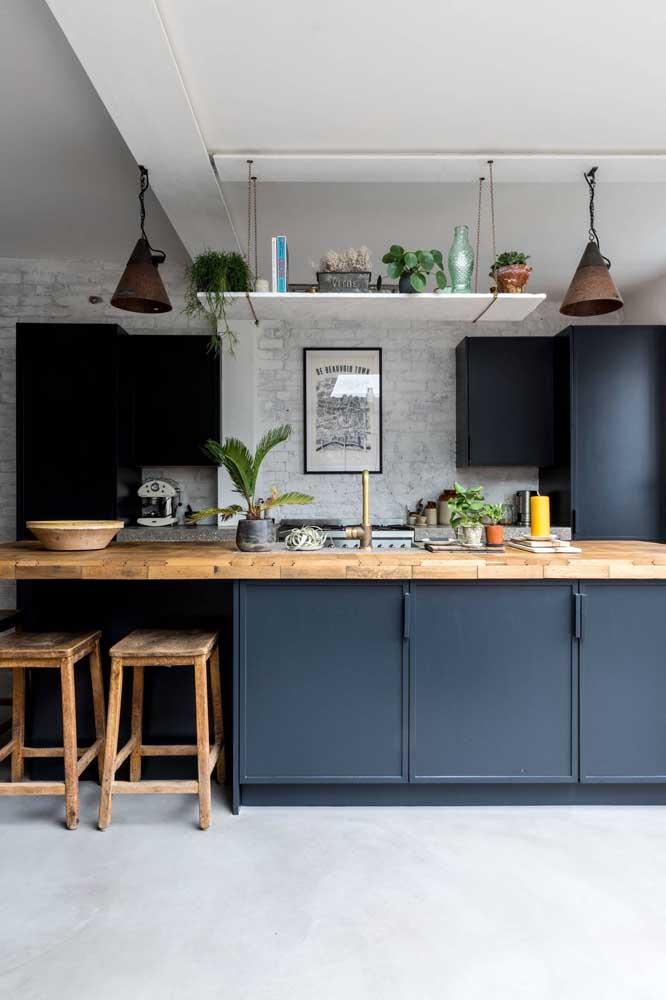 Cozinha gourmet com parede de tijolinhos à vista