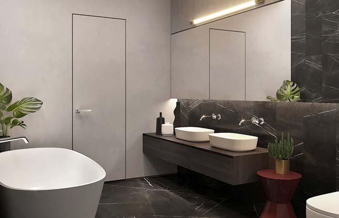 Piso e meia parede com granito preto