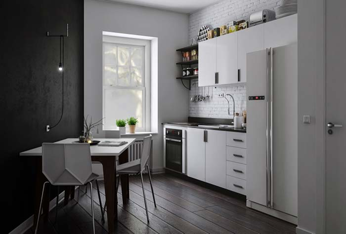 Cozinha preto e branca explorando os efeitos de luz e sombra