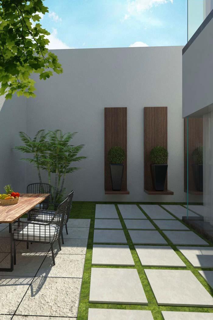 Vasos elegantes valorizam a parede do quintal