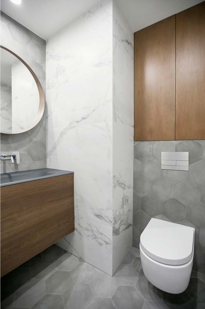 Madeira e pedras naturais no lavabo