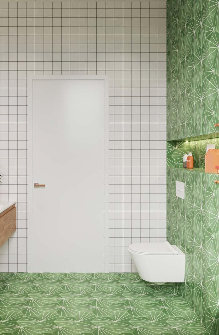 Azulejos verdes no banheiro feminino