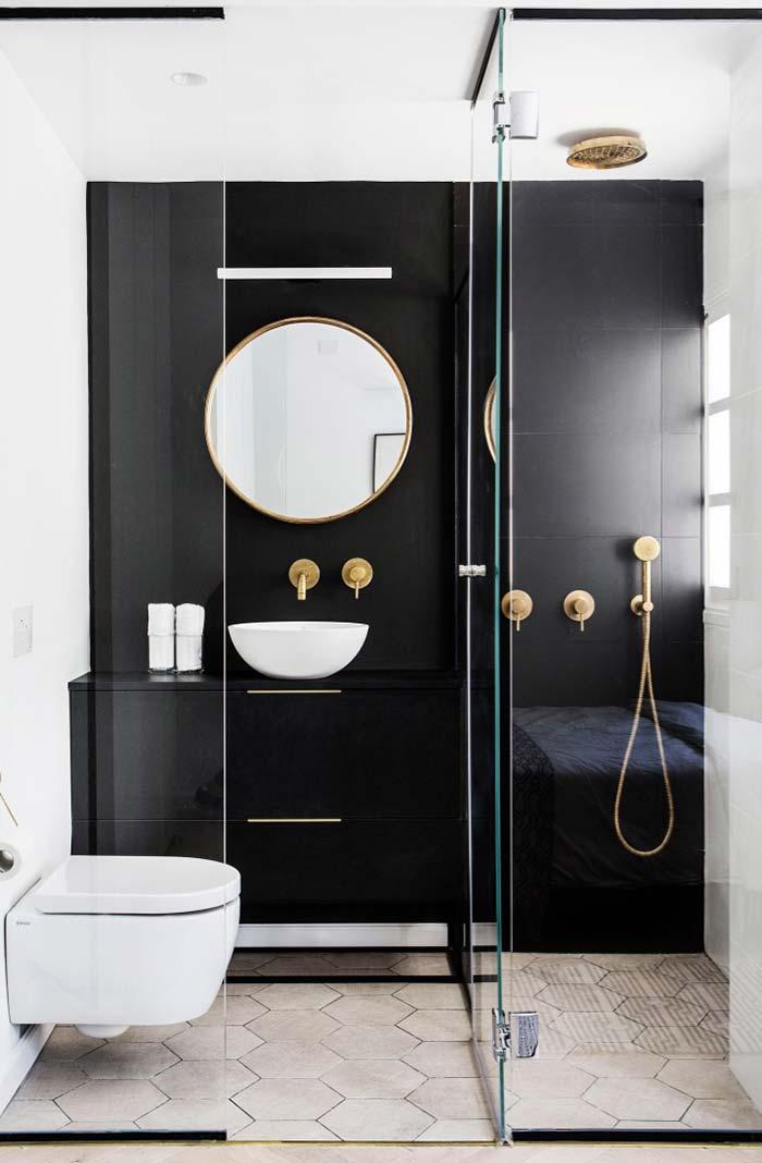Banheiro feminino preto e dourado