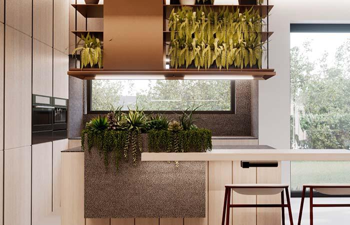 Cozinha deccorada: plantas na bancada e nos nichos superiores valorizam o estilo minimalista da cozinha