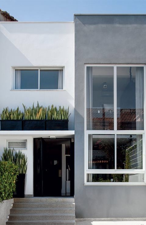 Modelos de casas de alvenaria com janelas grandes