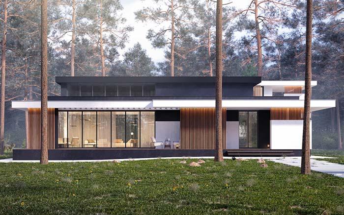 Casa com estrutura metálica em meio à natureza