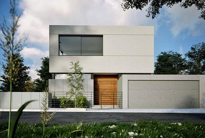 Modelo de casa de concreto marcada pelas linhas retas e pela cor cinza
