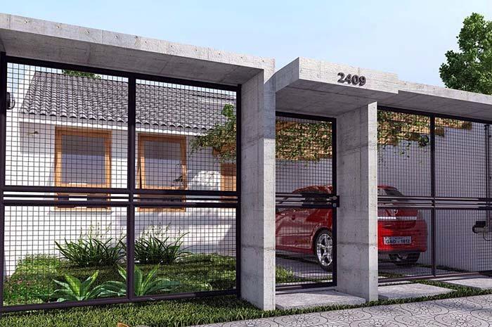 Casa simples ganha destaque com muro moderno e de estrutura metálica