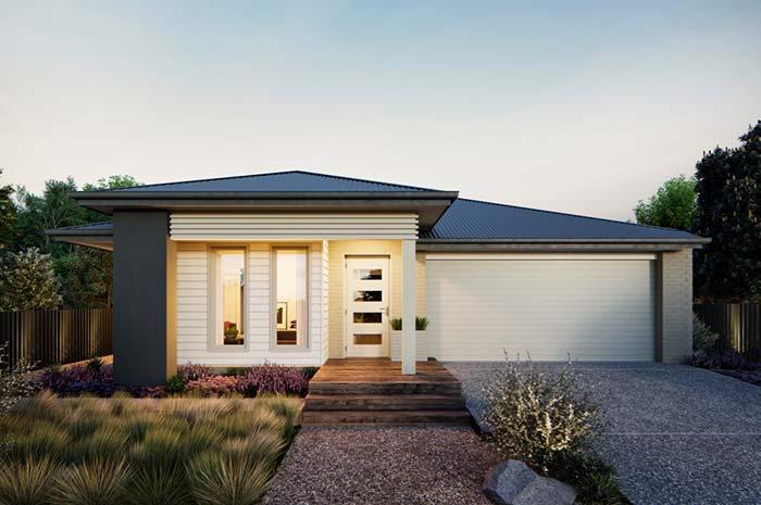Caminho de pedras e jardim para valorizar a fachada da casa