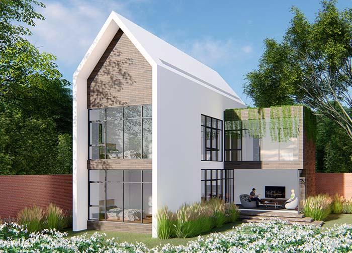 No estilo capelinha, essa casa se destaca pelas paredes de vidro.
