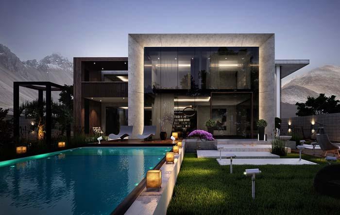 Piscina com bordas pretas em combinação com a arquitetura da casa.