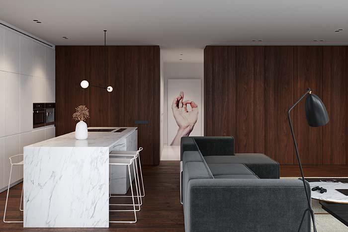 Linhas retas, móveis lisos e cores neutras predominam a decoração da sala.