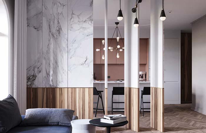 Granito e madeira compondo as características linhas modernistas.