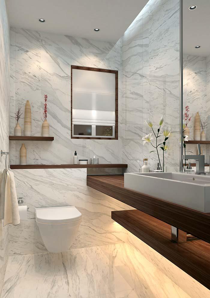 Mármore branco Calacatta revestindo chão e paredes do banheiro
