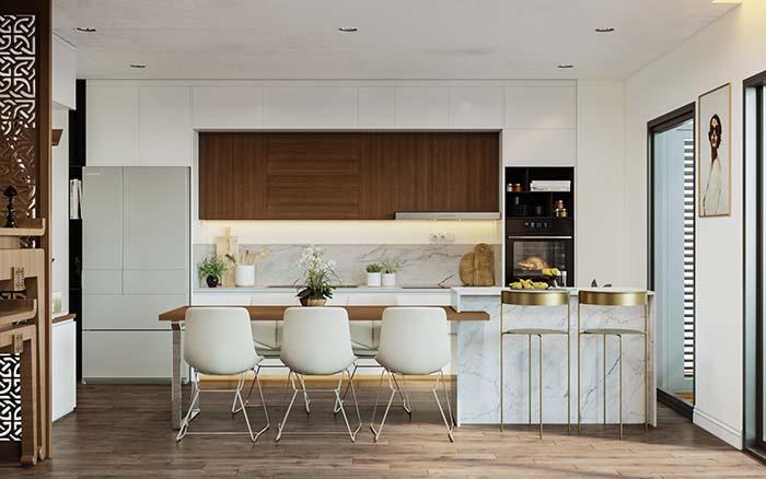 Bancada e balcão da cozinha feitos em mármore branco calacatta