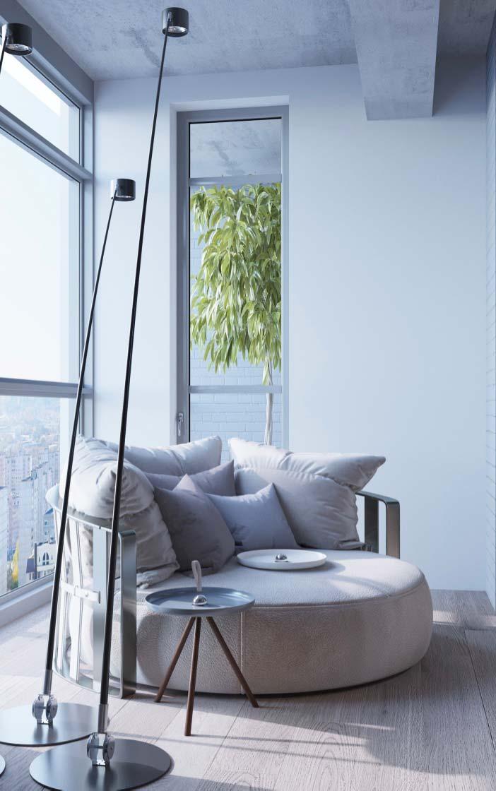 Sofá redondo na varanda