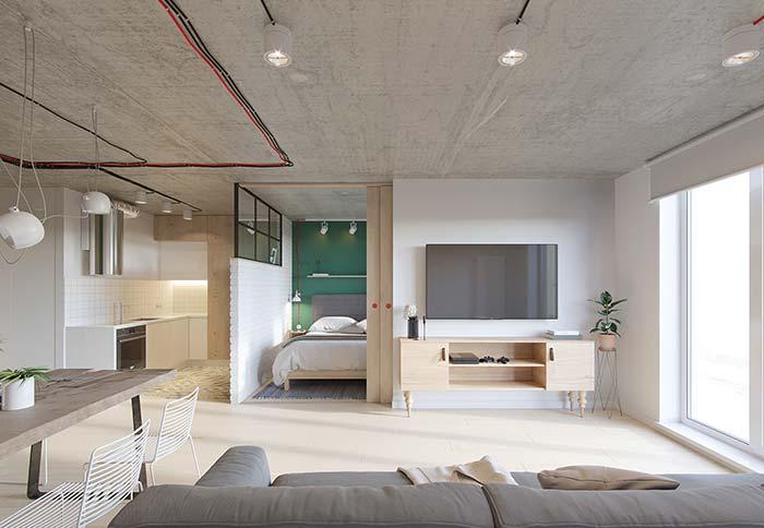 Decoração de apartamento com teto de cimento queimado