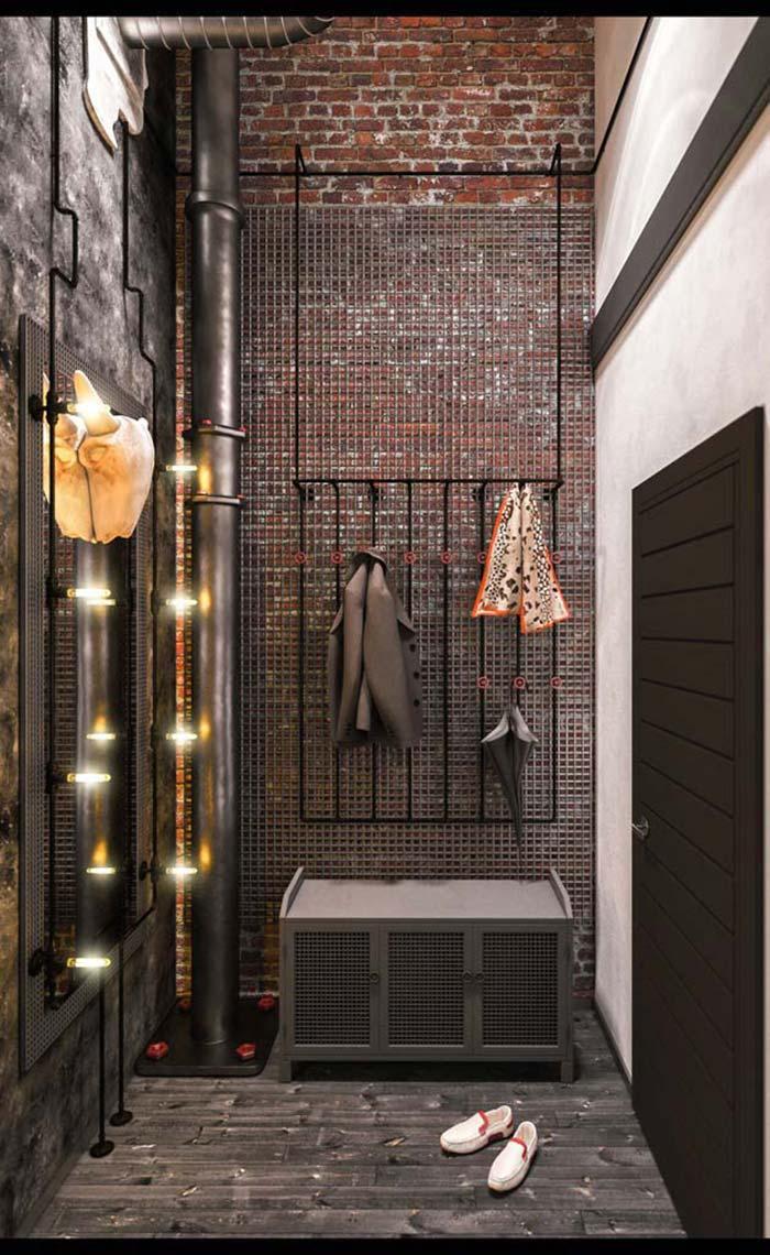 Closet de estilo industrial com parede de tijolos