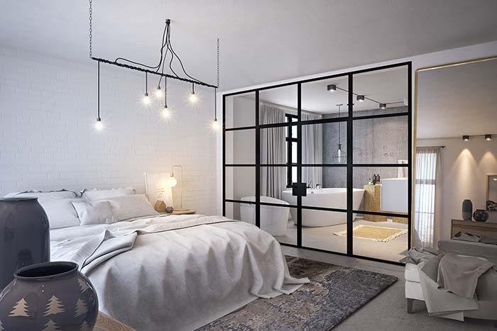 Parede de tijolos em quarto de casal clean