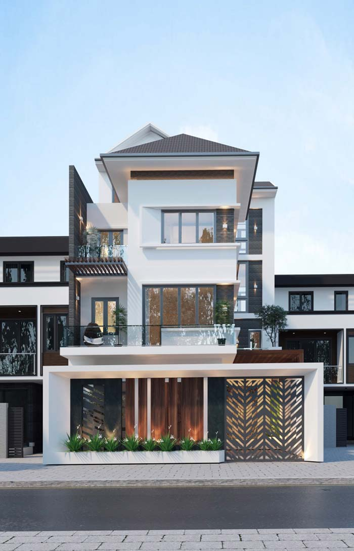 Ferro, granito e madeira na fachada da casa